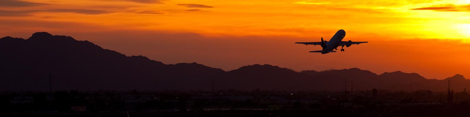 Plane silhouette sunset